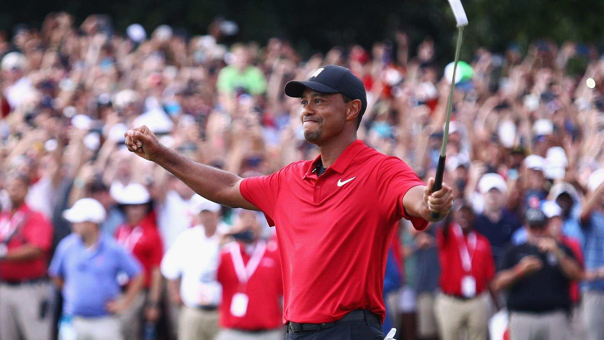 ATLANTA, GA - SEPTEMBER 23: Tiger Woods of the United States celebrates making a par on the 18th green to win the TOUR Championship at East Lake Golf Club on September 23, 2018 in Atlanta, Georgia.   Tim Bradbury/Getty Images/AFP== FOR NEWSPAPERS, INTERNET, TELCOS & TELEVISION USE ONLY ==