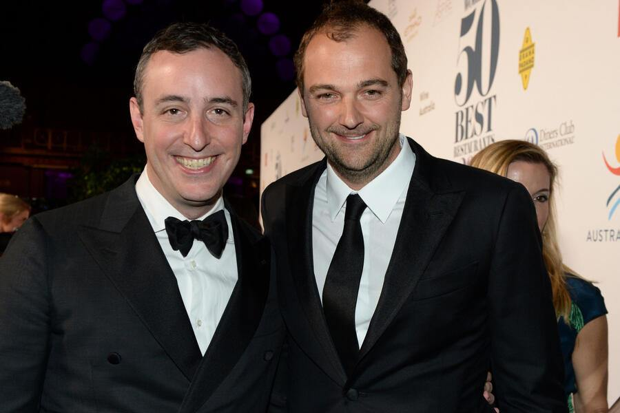 Will Gudara and Daniel Humm pose on the red carpet during the World's 50 Best Restaurants awards in Melbourne on April 5, 2017. The awards this year were held outside of London or New York for the first time with Australia fast earning a reputation as a serious food destination, attracting some of the world's top chefs to open restaurants Down Under. / AFP PHOTO / Mal Fairclough