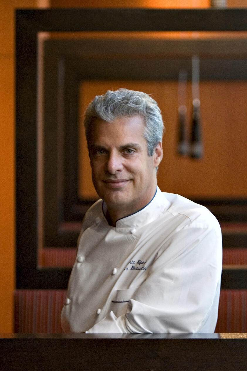 FILE-   This Monday, Oct. 15, 2007 file photo shows chef Eric Ripert as he stands in his restaurant, West End: A Bistro by Eric Ripert, at the Ritz-Carlton Hotel in Washington.  For AP's 20 Salads of Summer series, Eric Ripert offered a recipe he created while visiting Vietnam. It blends crunchy, tart green papaya with shrimp and calamari, then dresses everything with fresh mint and cilantro and a splash of lime juice and pungent fish sauce.    (AP Photo/J. Scott Applewhite)