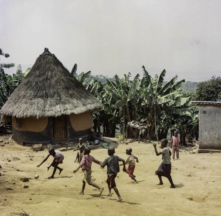 Local kids play football in the courtyard, Honde Valley, Zimbabwe