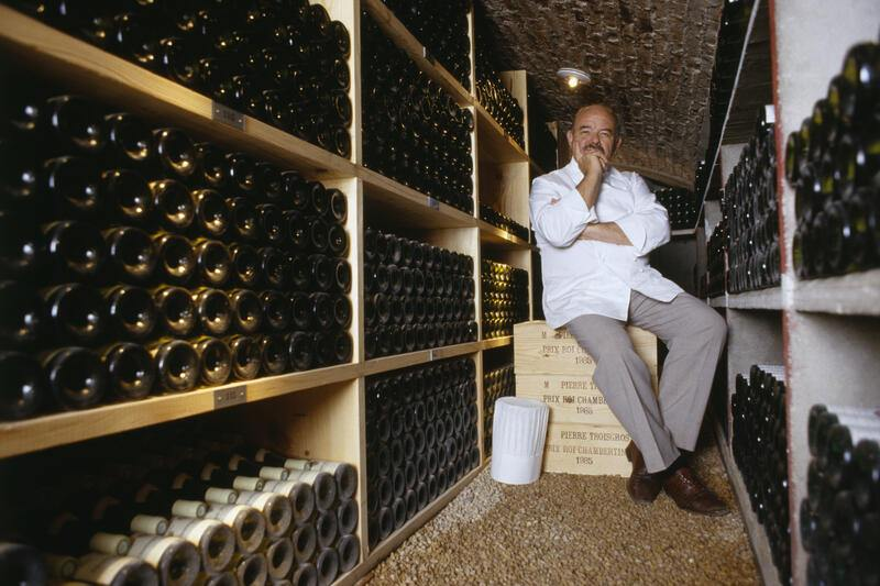 "Chef Pierre Troisgros sitting in the wine cellar of his restaurant ""Troisgros"" in Roanne which has had 3 Michelin stars awarded to it since 1968. (Photo by Eric Préau/Sygma via Getty Images)"